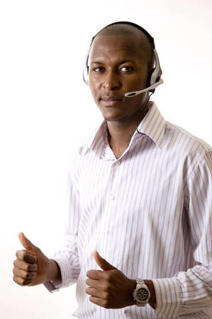 This is an image of a man with a microphone headset on. This image can be used for telecommunication and service themes. Stock Photo