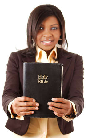This is an image of a woman holding a bible. photo