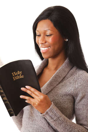 This is an image of a woman reading a bible whilst happy.