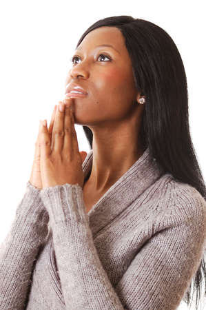 This is an image of a woman focussing in prayer.