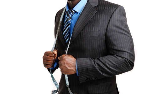 This is an image of business man wearing a tape measure across his suit. Stock Photo - 4290059