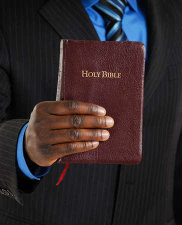 This is an image of a business man holding a bible.