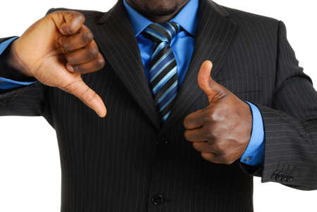 This is an image of a business man showing thumbs up and thumbs down. photo