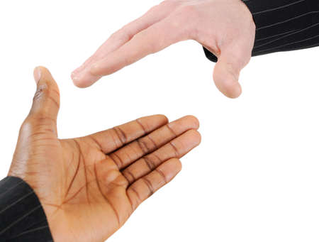 This is an image of two business men performing a handshake.