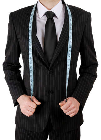 This is an image of business man wearing a tape measure across his suit.