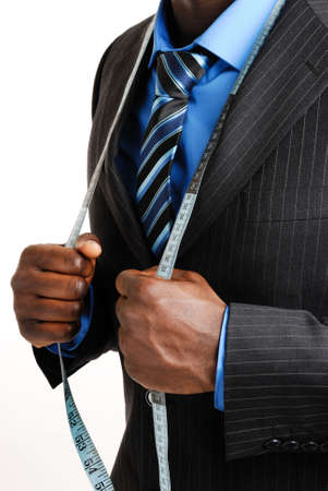 tailor measuring tape: This is an image of business man wearing a tape measure across his suit.