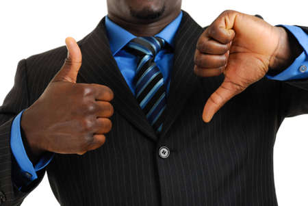 This is an image of a business man showing thumbs up and thumbs down. Stock Photo - 5210612