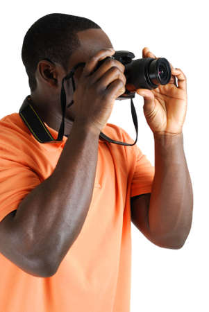 This is an image of a student photographer taking a picture with camera. Stock Photo