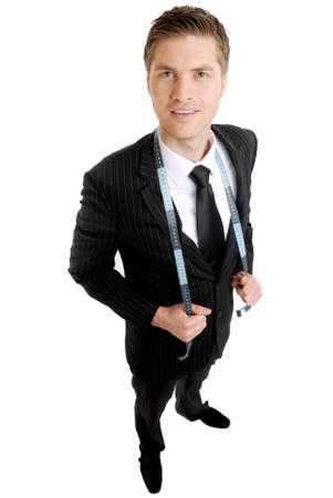 cinta de medir: Se trata de una imagen de hombre de negocios con una cinta m�trica en su traje.