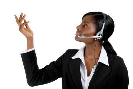 This is an image of a  business woman wearing microphone headset. This image can be used for telecommunication and service themes. Stock Photo