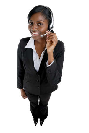 telephonist: This is an image of a  business woman wearing microphone headset. This image can be used for telecommunication and service themes. Stock Photo