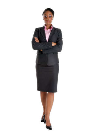 This is an image of a business woman standing confidently and looking serious.