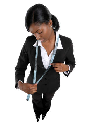 This is an image of business woman using a measuring tape. Stock Photo - 9393158