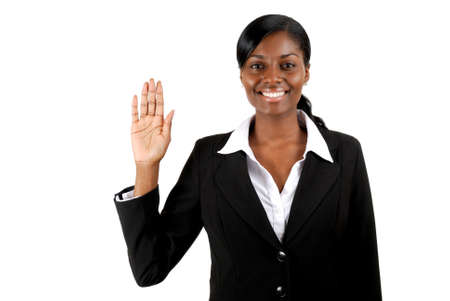 This is an image of business woman with her hand up.