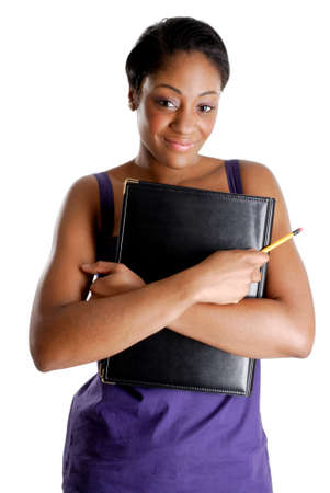 This is an image of female student holding a pencil and book. photo