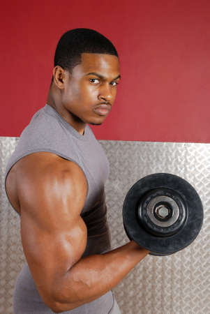tricep: This is an image of a man lifting weights. Stock Photo
