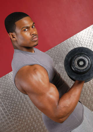 This is an image of a man lifting weights. Stock Photo - 9413371