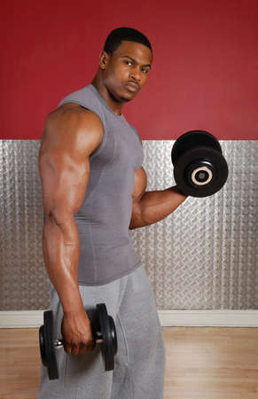 man lifting weights: This is an image of a man lifting weights. Stock Photo