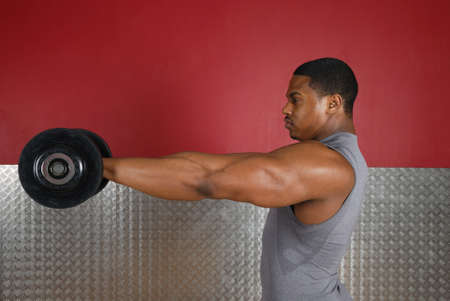 This is an image of a man lifting weights. Stock Photo
