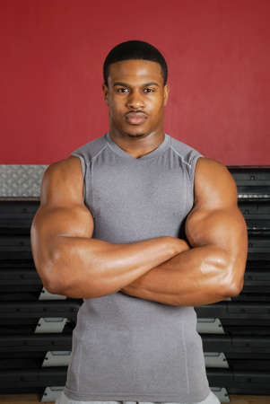 muscular body: This is an image of a muscular man in the gym.