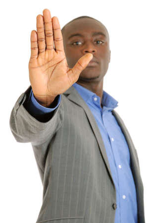 This is an image of a business man with hand stop sign. photo