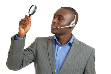This is an image of a customer support operator holding magnifying glass. photo