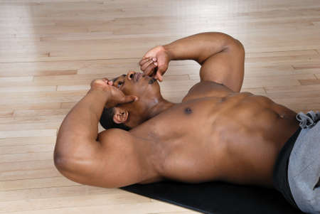 This is an image of a man performing sit ups. Stock Photo - 9413378