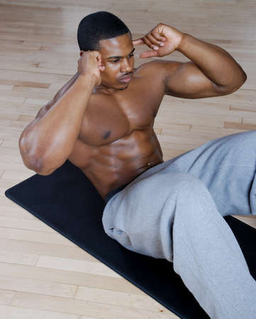 sit ups: This is an image of a man performing sit ups.