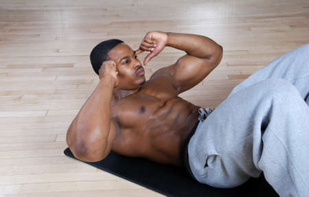 This is an image of a man performing sit ups.  photo