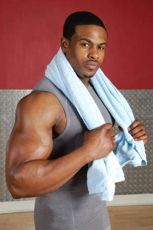 This is an image of a fitness trainer holding towel. photo
