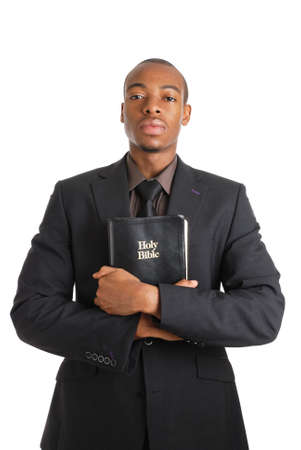 This is an image of a man holding a bible showing commitment.