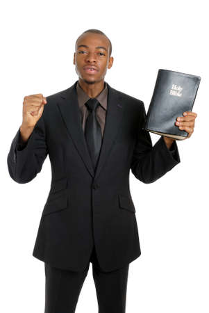 This is an image of a man holding a bible preaching the gospel. photo