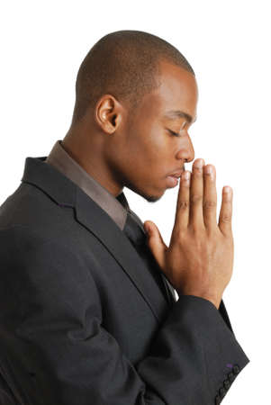 This is an image of a business man praying, using prayer gesture.