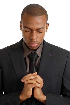 hombre orando: Se trata de una imagen de un hombre de negocios orando, con gesto de oraci�n.