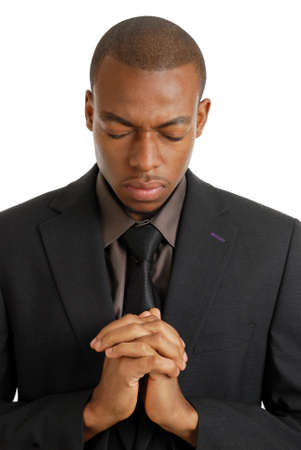 closed eye: This is an image of a business man praying, using prayer gesture.