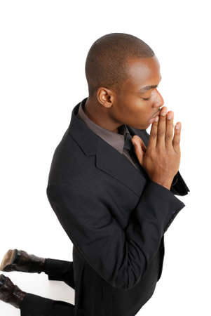 This is an image of business man on his knees praying.