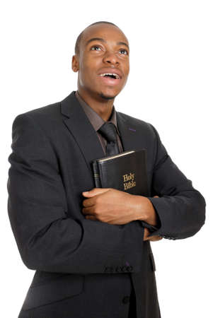 This is an image of a man holding a bible showing commitment. photo