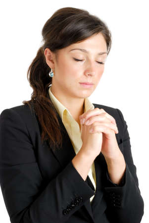 This is an image of young business woman praying. Stock Photo