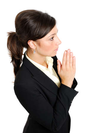 This is an image of young business woman praying. photo