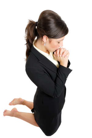 assertive: This is an image of business woman kneeling and praying. Stock Photo