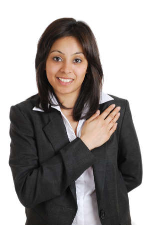 promise: This is an image of a business woman  pledging with her hand on chest