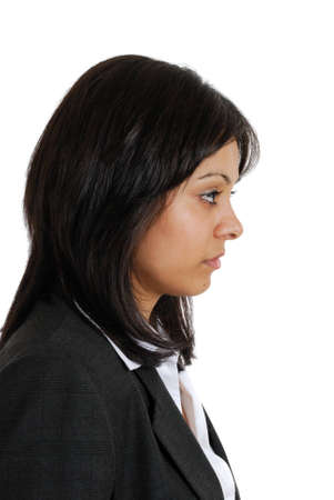 seriousness: This is an image of a business woman looking away in seriousness.