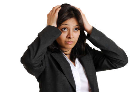 This is an image of a business woman with her hands on her head due to business failure.