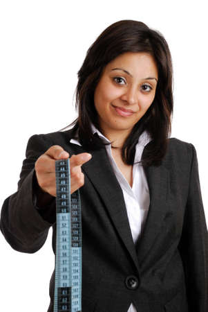 This is an image a business woman holding a measuring tape. photo