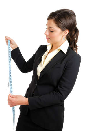 This is an image a business woman using a measuring tape. Stock Photo - 9425152