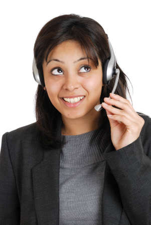 This is an image of business woman wearing communications headset. photo