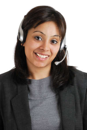 This is an image of business woman wearing communications headset.