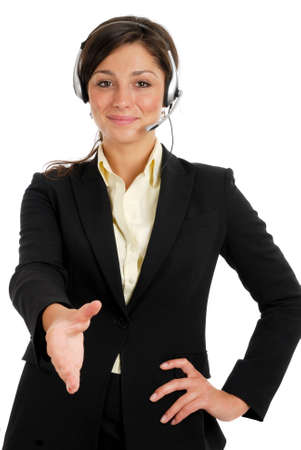 This is an image of business woman with headset offering a handshake. Stock Photo