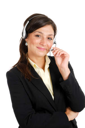 This is an image of a confident communcations business woman holding her headset.
