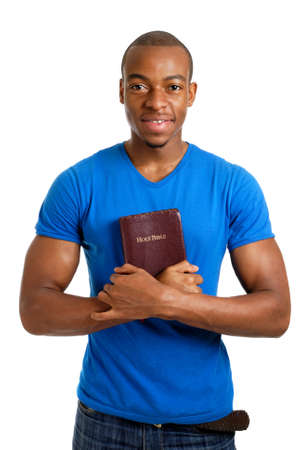 This is an image of student holding a bible showing commitment.